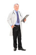 Full length portrait of a mature doctor holding a clipboard