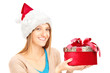 Smiling female with christmas hat holding a present