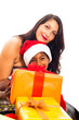 Beautiful woman with boy and Christmas gifts