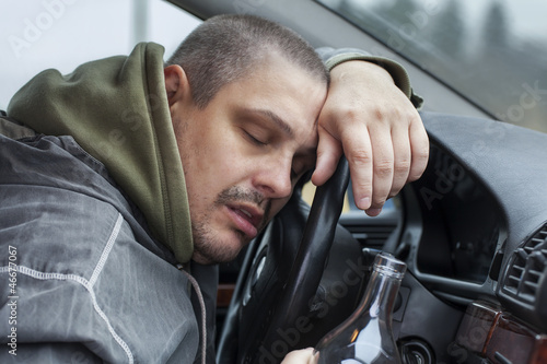 Drunk man lying on the steering wheel