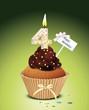 Cupcake mit Geburtstagskerze die Zahl 4