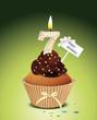 Cupcake mit Geburtstagskerze die Zahl 7