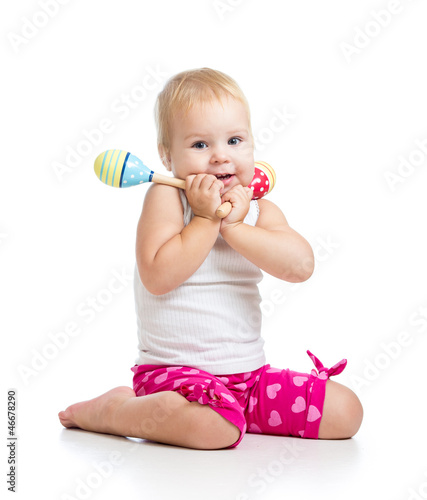 Kid playing with musical toys. Isolated on white background