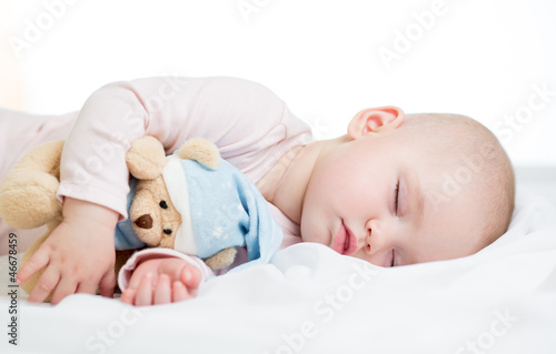 baby girl sleeping with toy