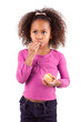 Little African Asian girl eating a tangerine