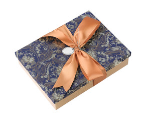 A beautiful fabric gift box with golden ribbon