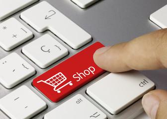 Shop keyboard. Finger