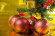 four red ball and chrismas tree on gold background