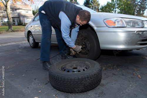 Car mechanic changing a car wheels