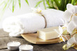 Spa soap with orchids and towel on wooden boards