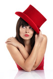 Portrait of a beautiful and playful girl with red hat