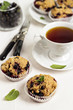 Black currant muffins with a cup of tea
