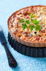 Quiche with tuna and capers. Selective focus
