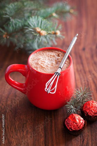 Hot cocoa in mug and chocolates. Selective focus