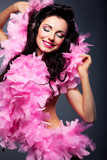 Elated positive woman in pink dress listening to the music poster