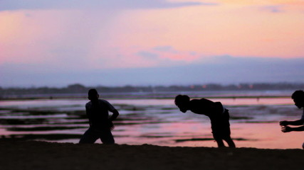 silhouette teenagers training parkour