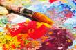 Leinwanddruck Bild - Brush dipped in yellow