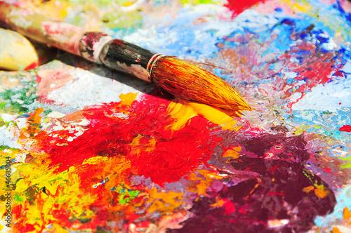 Leinwanddruck Bild Brush dipped in yellow