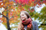 Outdoor autumn portrait of a beautiful blond girl