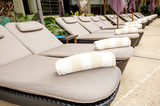Relaxing sun beds at swimming pool