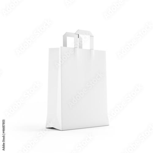 Leinwandbild Motiv White paper bag isolated on white