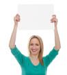 beautiful woman holding a blank board