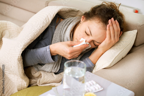 Sick Woman. Flu. Woman Caught Cold. Sneezing into Tissue - 46688223