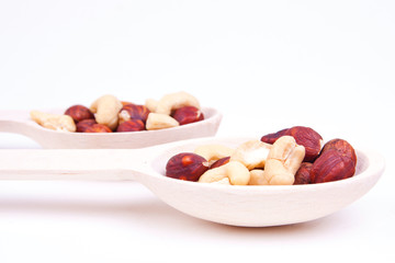 nuts are in a wooden spoon