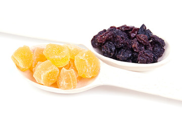 raisin and dried pineapple in a wooden spoon