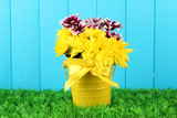 beautiful bouquet of chrysanthemums in a bright colorful bucket