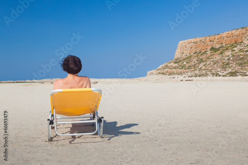 Woman alone on the beach 6