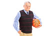A gentleman holding a basketball