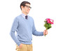 A young man holding flowers