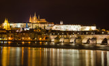 Fototapety Cityscape of Prague with Castle and Charles Bridge at night, Cze