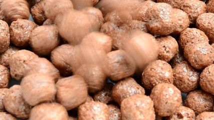 Pile of choco balls cereal pouring into isolated background