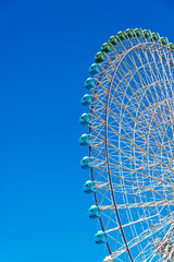 Ferris wheel in blue sky, Yokohama, Japan.
