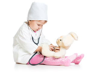 Adorable child with clothes of doctor and hare toy over white