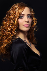 Portrait of a beautiful girl with curly hair