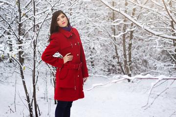 Beautiful elegant woman in red coat