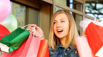 Happy woman shopping and holding bags