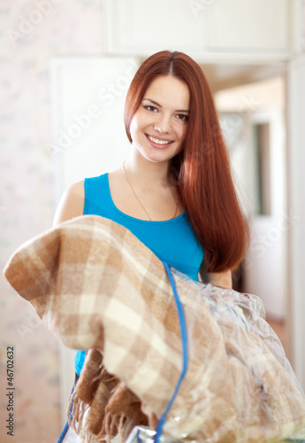 Happy woman with new plaid