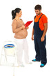 Pregnant woman converse with workman