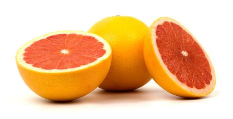Grapefruit with slice on white background