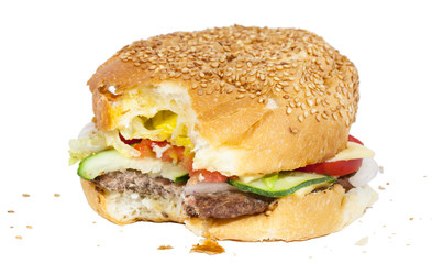 Bitten burger with crumbs isolated on white