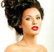 brunette with curly hair and red lipstiks