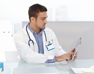 Young doctor using tablet computer