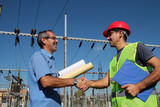 Engineer and Worker at Electrical Substation