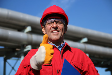 Smiling Industrial Worker Giving Thumb Up