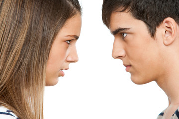 Teen couple with cross face expression.