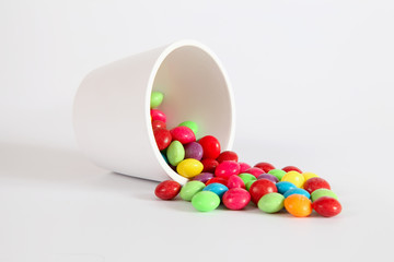White Jar  full of multicolored candies
